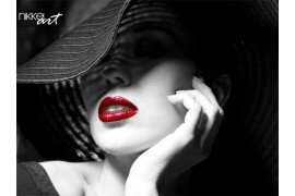 Portrait of mysterious beautiful young woman with wonderful skin texture in black hat