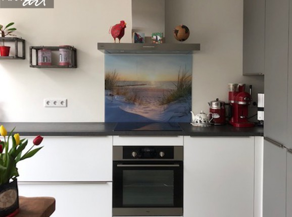 Glazen keukenwand strand