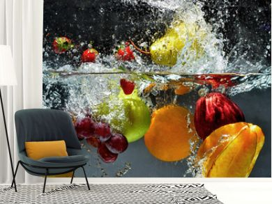 Fruit and vegetables splash into water