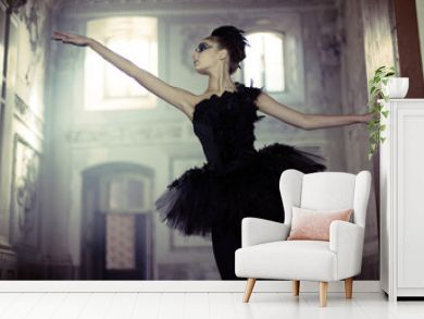 Black swan ballet dancer in move