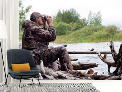 man with binoculars in the hunt