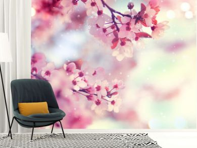 Spring border or background art with pink blossom. Beautiful nature scene with blooming tree and sun flare