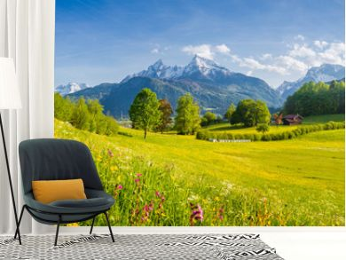 Beautiful summer landscape in the Alps with blooming meadows in spring