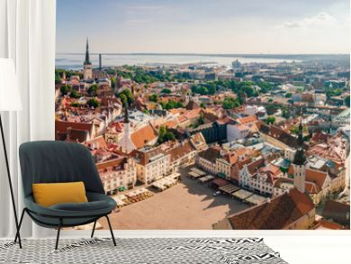 Amazing aerial view of the Tallinn old town with many old houses sea and castle on the horizon.