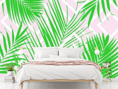 Vector tropical palm leaves on pink background