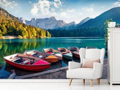 Six pleasure boats on Fusine lake. Splendid morning scene of Julian Alps with Mangart peak on background, Province of Udine, Italy, Europe. Traveling concept background.