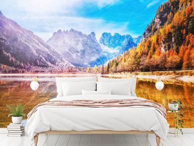 Beautiful seasonal Aurumnal scenery of mountain lake in Dolomite Alps in Italy. Beautiful Alpine landscape. Autumn in Alps.