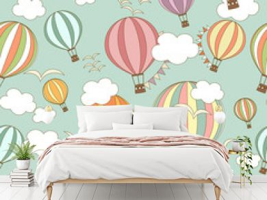 Colored striped hot air balloons with clouds in the sky. Seamless pattern. Cute background, kids wallpaper. Vector illustration