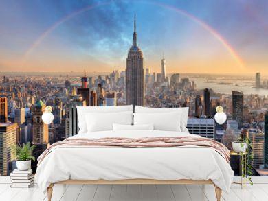 New York City skyline with urban skyscrapers and rainbow.