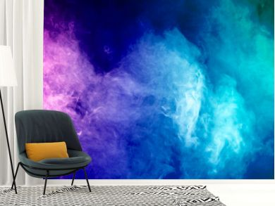 Colorful smoke clouds on dark background