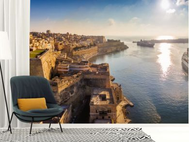 Valletta, Malta - Panoramic aerial skyline view of Valletta when cruise ships sailing in the Grand harbor at surnise