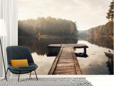 The Breath Of Autumn. Autumn foliage and fog lake in morning with boat dock