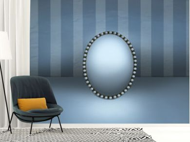 Small mirror with vintage frame decorated in pearls resting on a floor and with striped wall background