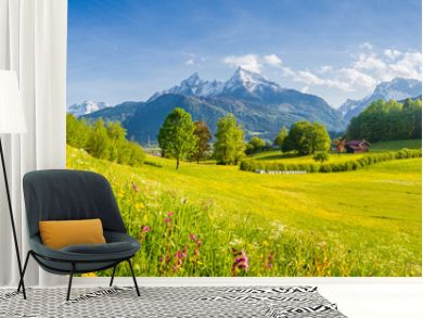 Idyllic mountain scenery in the Alps with blooming meadows in springtime