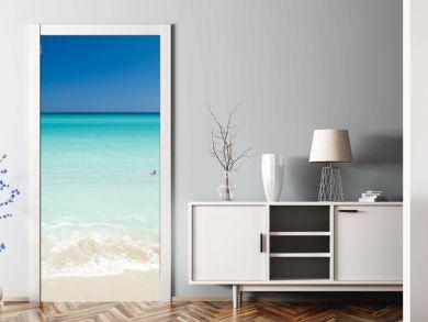 Shore of classic turquoise Caribbean Sea dream beach under bright blue sky in Varadero, Cuba