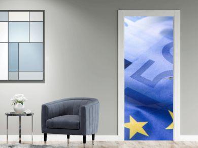 Euro flag. Euro money. Euro currency. Colorful waving european union flag on a euro money background.