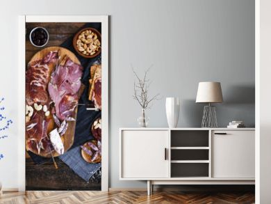 Tapas selection. A cutting board with charcuterie. Spanish cured meat, jamon, lomo, chorizo, salchichon. Charcuterie concept. Top view.