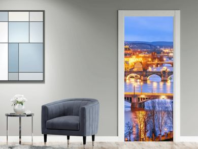 Classic view of Prague at Twilight, panorama of Bridges on Vltava, view from above, beautiful bridges vista. Winter scenery. Prague is famous and extremely popular travel destination. Czech Republic.
