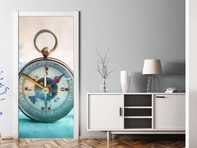 Magnetic compass  and location marking with a pin on routes on world map. Adventure, discovery, navigation, communication, logistics, geography, transport and travel theme concept background..