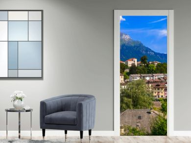 Breathtaking panorama of beautiful Belluno town surrounded by Dolomite mountains, northern Italy