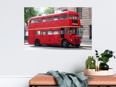 Empty red double-decker on street in London, England.