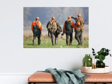 Vier Jäger nach der Treibjagd