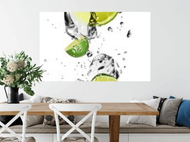 Limes with ice cubes, isolated on white background