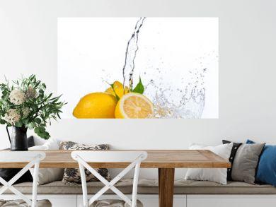 Fresh lemons with water splash, isolated on white background