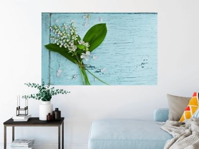 Lovely bouquet of lilies of the valley on a blue wooden table