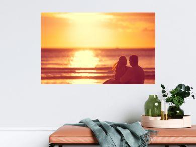 Romantic couple looking sunset