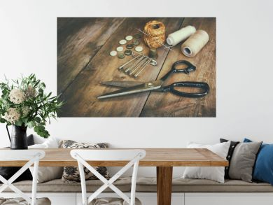 Vintage Background with sewing tools and sewing kit over wooden