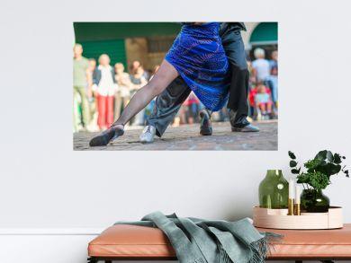 Couple dancing tango in the street