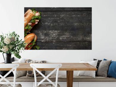 Two tuna sandwich on dark wood background