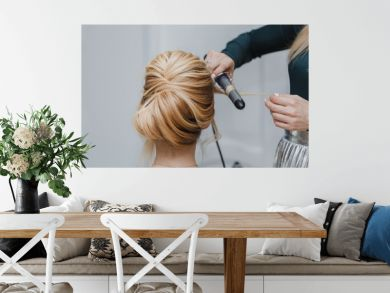 closeup of professional hairdresser hands doing beauty hairstyle