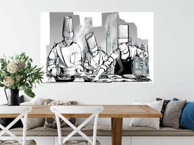 Chefs in a restaurant kitchen cooking