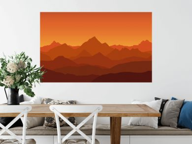 panoramic view of the mountain landscape with fog in the valley below with the alpenglow orange sky