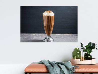 Chocolate milkshake on the rustic background. Selective focus.