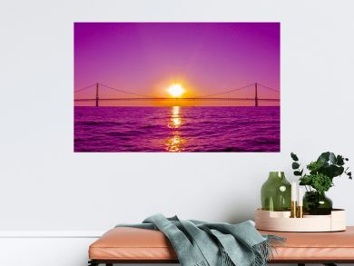 Sunset view and Mackinac Bridge in Michigan, USA. This is a long steel suspension bridge located in the Great lakes region and one of the most famous landmarks of North America.