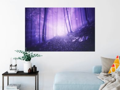Fantasy pink colored foggy forest landscape with magic firefly lights background.