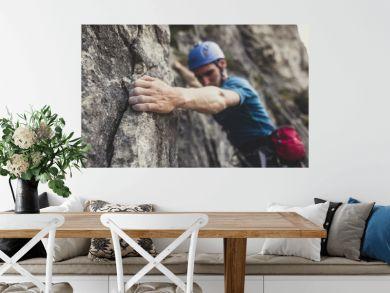 Mountaineer Climbing a Rock