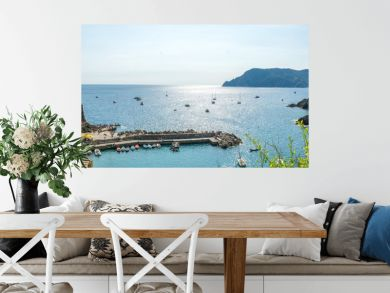 Panoramic View of the Bay in front of the Town of Vernazza on Blue Sky Background.
