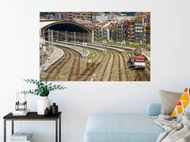 Aerial view of  locomotive train running along the railway track and train station in Bilbao, Spain