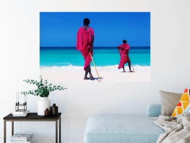 Two maasai warriors looking on ocean.