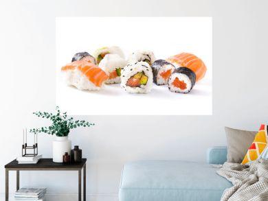 sushi assortment on black tray isolated on white background