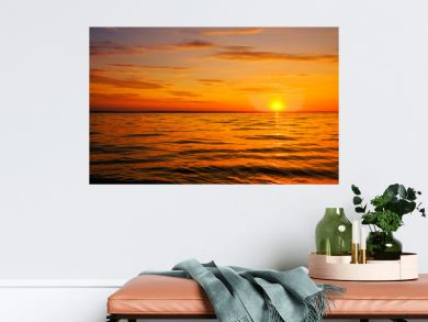 Beautiful fiery sunset sky on the beach. Composition of nature