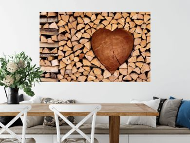 Firewood, nicely assembled in the shape of heart, romantic background, wooden texture, nature background
