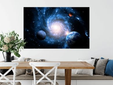 Planets of the solar system against the background of a spiral galaxy in space. Elements of this image furnished by NASA.