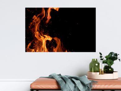 MACRO: Beautiful bright orange flames flicker in the darkness of the night.