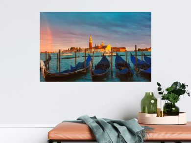 Colorful landscape with sunset sky, rainbow and gondolas parked near piazza San Marco in Venice. Church of San Giorgio Maggiore in the background, Italy. Europe tourism concept.