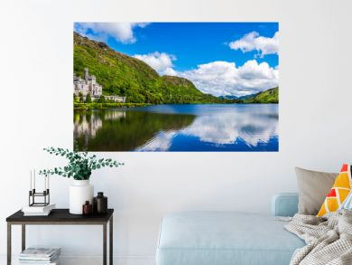 Panorama of Kylemore Abbey, beautiful castle like abbey reflected in lake at the foot of a mountain. Benedictine monastery, in Connemara, Ireland